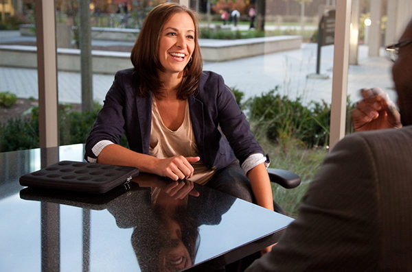 Image of a woman smiling in a meeting